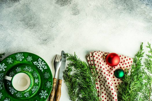 Empty plate with festive decor and cutlery on table fot Christmas dinner