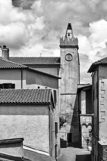 Historic clock tower in the city of Magliano in Toscana