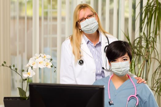 Doctor and Nurse At Office Desk Wearing Medical Face Masks.
