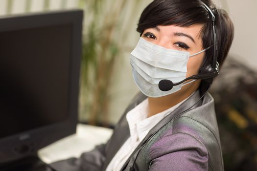 Woman At Office Desk Wearing Medical Face Mask.