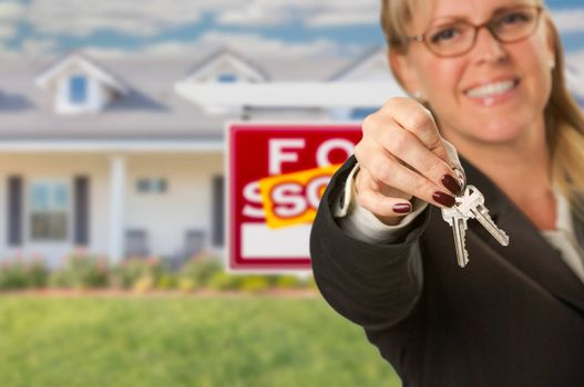 Real Estate Agent Handing Over New House Keys with Sold Sign Behind.