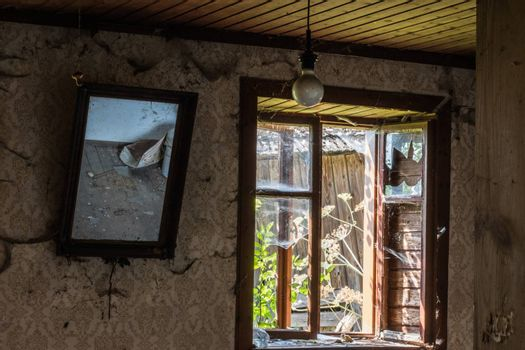 mirror and window in a abandoned farmhouse on the country
