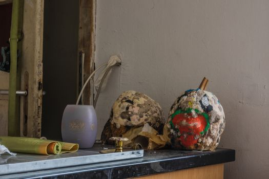 painted pumpkins with mold in a house