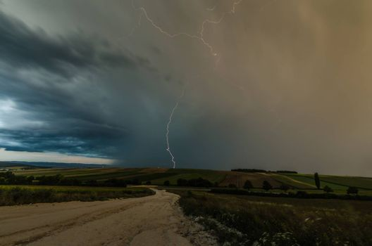 thunderstorm with rain clouds and lightning in the landscape