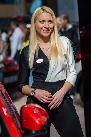 Belgrade / Serbia - March 23, 2019: Beautiful hostess girl at the Belgrade Car and Motor Show in Belgrade, Serbia