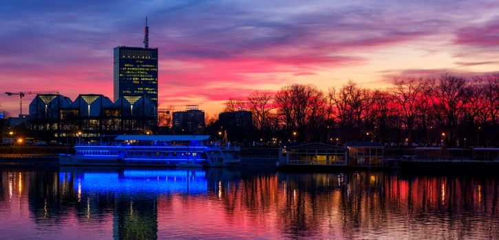 Belgrade / Serbia - March 4, 2019: Colorful sunset view of Usce Tower in Belgrade, Serbia, reflecting in the Sava river. Bombed by NATO in 1999, Usce Tower is the highest building in Serbia