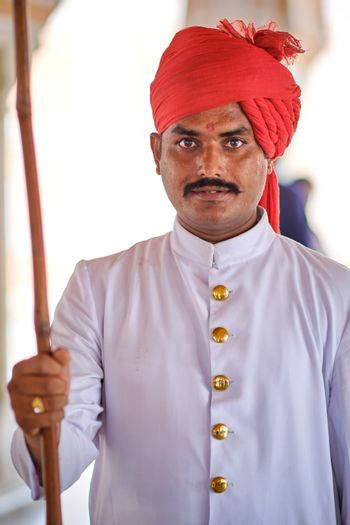 Jaipur, Rajasthan / India - September 29, 2019: Portrait of a young Indian man in traditional Rajasthani clothes wearing turban safa hat, Jaipur, India