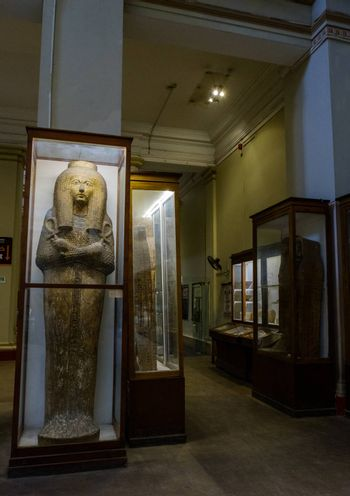 Cairo / Egypt - May 25, 2019: Ancient Egyptian sarcophagi and mummy caskets displayed in the Museum of Egyptian Antiquities (Egyptian Museum) in Cairo, capital of Egypt