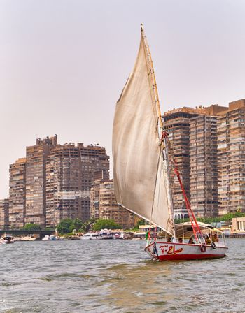Cairo / Egypt - May 25th 2019: Felucca boat, traditional wooden sailing boat popular for taking tourists on a river cruise on the Nile river in Cairo, Egypt