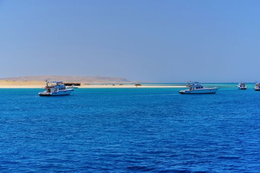 Sandy beach and clear blue waters rich in coral reefs of Giftun island near Hurghada, Red Sea coast, Egypt