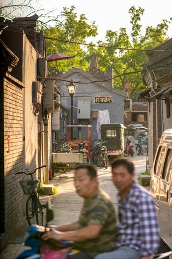 Beijing / China - May 21, 2016: Small Hutong back alley in central Beijing, the capital of China