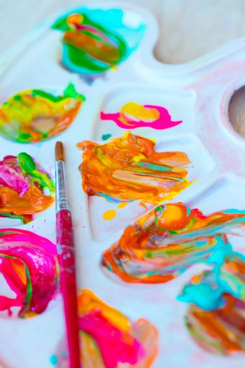 Closeup Photo of a Bright Colorful Paint. Art and Creativity Background