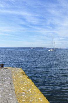 Sailboat entering the port