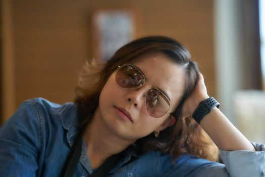 portrait of woman wear sunglasses in relax pose with wrist watch