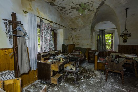 room with objects and wooden furniture with mold