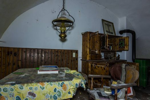 seat with lantern and wooden furniture in a house