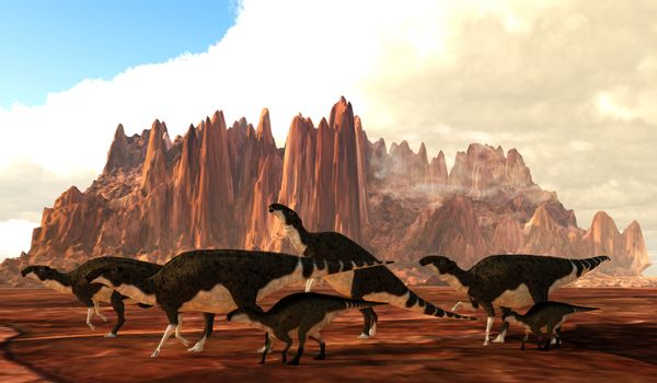 A herd of Brachylophosaurus dinosaurs cross a desert area during the Cretaceous Period of Canada and the United States.