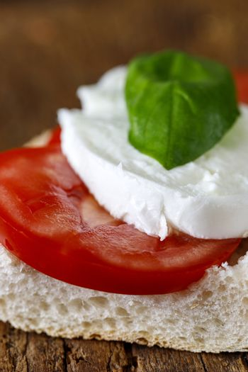 italian caprese sandwich on wood