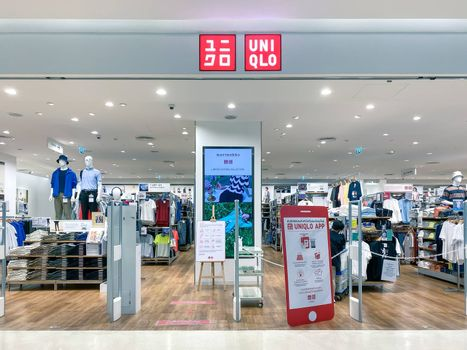 Uniqlo logo in front of the store, a Japanese casual wear designer, manufacturer and retailer, design of logo is flat and bold