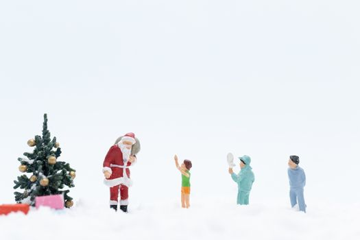 Miniature people, Santa claus and gifts for kid , Christmas and Happy New Year concept.
