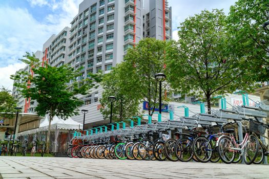 Bike parking lot at Punggol MRT/LRT station in Singapore. Punggol is planning area and new town situated on Tanjong Punggol peninsula in North-East Region of Singapore
