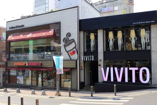 Vivito store of Carver Korea cosmetic, a beauty industry and Dunkin' Donuts shop, a coffee and doughnut company on Street Market in Ewha Womans University area.
