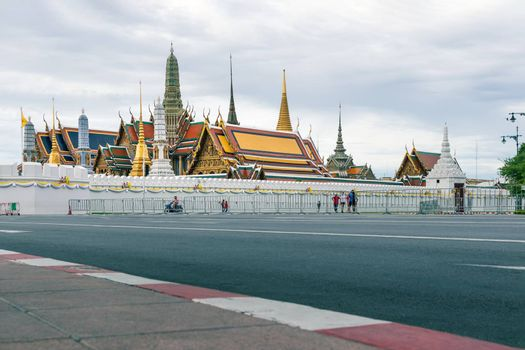 Wat Phra Kaew on cloudy day. The place is regarded as the most sacred Buddhist temple in Thailand. There is the Emerald Buddha housed in temple. Tourist destination