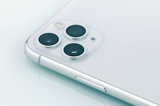 The triple camera system of ultra wide, wide and telephoto lenses on iPhone11 Pro Max, a smartphone designed and marketed by Apple Inc. released in 2019.