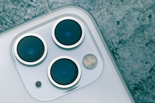 Close up shot for scratch on iPhone11 Pro Max rear camera lens, the triple camera system of ultra wide, wide and telephoto lenses. lenses should have been protected