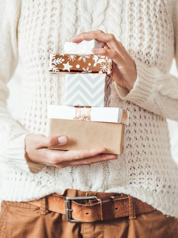 Woman in cable-knit white sweater with Scandinavian pattern and