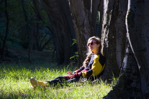 Woman in the botanic garden and park, trees and casual young girl portrait in garden