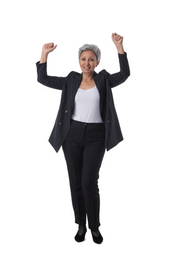 Mature asian business woman winner with raised arms isolated on white background full length studio portrait