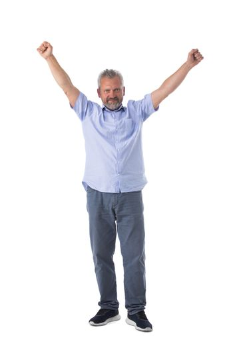 Senior business man winner with raised arms isolated on white background full length studio portrait