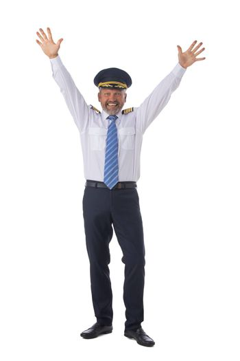 Airline pilot wearing the four bar Captains epaulettes, firlst pilot, aircraft commander with raised arms isolated on white background full length studio portrait