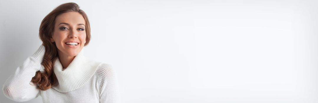 Portrait of woman in knitted pullover