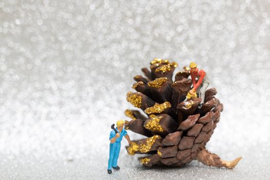 Miniature people,  Worker team prepared a Christmas pine cone , Christmas and Happy New Year concept.