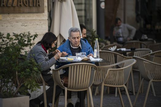 terni,italy october 21 2020:husband and wife sitting at the bar having lunch