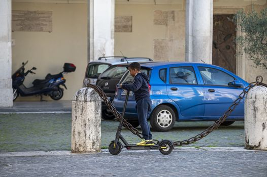 terni,italy october 21 2020:black child going with mono skate