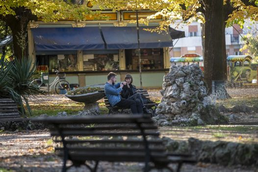 terni,italy october 21 2020:engaged couple sitting at the park