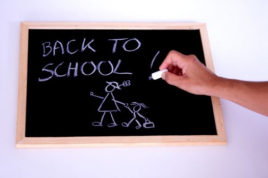 A hand writting back to school with a chalk