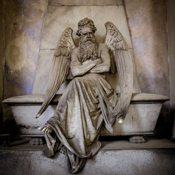 GENOA, ITALY - June 2020: antique statue of angel (beginning 1900, marble) in a Christian Catholic cemetery - Italy