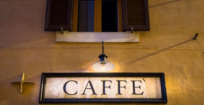 Rome, Italy. Tradiotional vintage style coffee sign on the wall.
