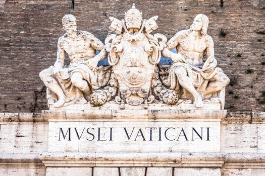 ROME, ITALY - CIRCA SEPTEMBER 2020: the famous Vatican Museum building. Detail of the sign above the main entrance.