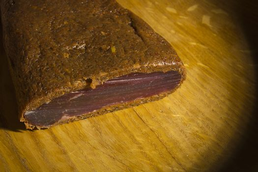 Piece of smoked meat on wooden board