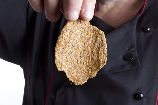 Rye chips in the hand of a male chef