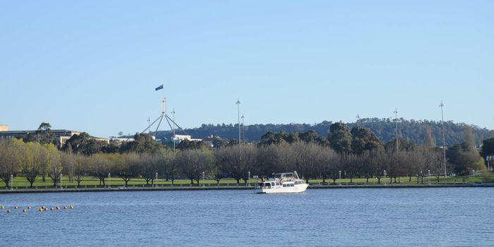 City lake and Australia parliament in Canberra