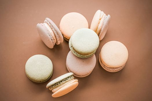 French macaroons on cream beige background, parisian chic cafe d