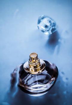 Perfume bottle under blue water, fresh sea coastal scent as glam