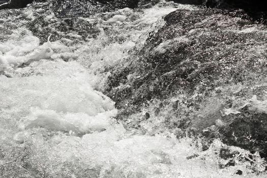 Fast flowing Storebottåne river water of the Vavatn lake in Hemsedal, Buskerud, Norway.