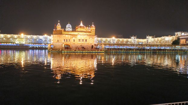 The Golden Temple or Harmandir Sahib or Darbar Sahib Gurdwara, the religious preeminent holy spiritual pilgrimage site of Sikhism. Amritsar, Punjab, India. South Asia Pacific October 2020.